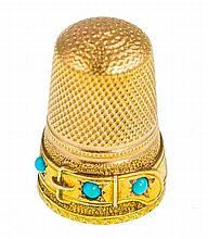AN ANTIQUE GOLD AND TURQUOISE THIMBLE