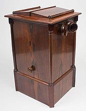 Stereoscope made of wood veneered with mahogany, - tabletop model with adjustable lenses and inside a carousel for 44 stereo photos, operated by means of a button on the outside, 54 x 31 x 335 cm. Lacks one of the corner pillars and one button as