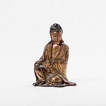 A red lacquered and gilt bronze seated Guanyin