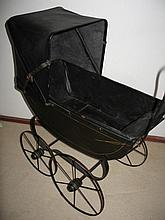Black wood child Doll pram c1920s, 76cm to replaced black leather hood