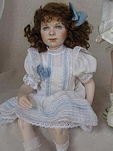 Two porcelain dolls:- Danbury Mint Shirley Temple by Elke Hutchins 38cm tod