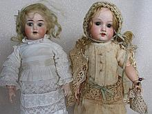 Two German bisque dolls on replaced composition bodies:- 32cm Armand Marsei
