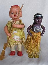 Two cellouid clockwork dolls. Brown 16cm Indian Dancer in grass skirt, key,