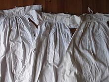 Three antique Victorian Child night whitewear garments, 74cm to 76cm two ha