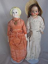 Two dolls:- Repainted shoulderhead German composition doll, vintage painted