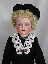 Japan painted bisque 48cm Nippon child. Fixed blue glass sleep eyes, angled