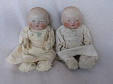 Four Japan frozen all-bisque dolls with jointed arms:- Two 16cm Babies one