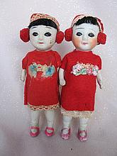 Three all-bisque:- frozen 16cm Japan Oriental dolls, jointed arms, sleep ey