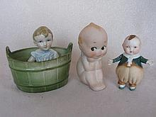 Three figurines:- 9cm all bisque Nippon Happifat, jointed arms. Nippon 11cm