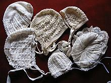 Five cream / white Doll Bonnets. Four are crochet with satin ties, one is m