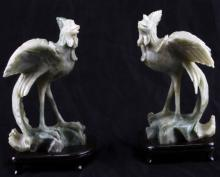 TWO GREEN SOAPSTONE BIRDS WITH WOOD PEDESTAL