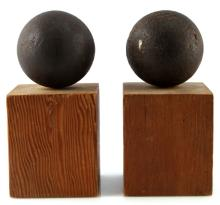 GROUPING OF TWO CIVIL WAR MOUNTED CANNONBALLS