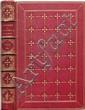 LA PUCELLE D'ORLÉANS, poëme en vingt-un chants par Voltaire. Paris, Leclere, 1865 ; in-8, chagrin rouge, double encadrement de filets dorés, semis de croix fleurdelisées encadrées de lobes à froid, treillis de filets dorés, dos à nerfs orné de