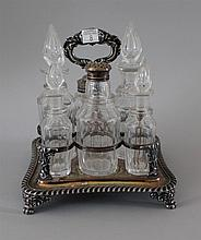 Castor Set. Silver-plated rack fitted for eight cut glass bottles. 8