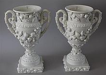 Pair of Double Handled Ceramic Urns. Spanish, applied fruit and flowers, 14