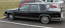 1986 Black Cadillac Sedan de Ville with Digital Fuel Injected HT 4100 V8 Engine, Red Leather Interior, with 2 Michelin, 1 Goodyear,...