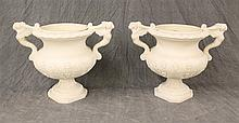 Pair of Resin Urns with Molded Designs, 17