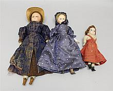 LOT OF (3) WAX-OVER SHOULDER HEAD DOLLS WITH GLASS EYES, WIGS. All of the dolls have cloth bodies, papier mache lower limbs with mol...