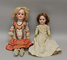 PAIR OF ARMAND MARSEILLE ANTIQUE BISQUE HEAD DOLLS. Both dolls have brown eyes, open mouths, papier mache bodies, antique clothing. ...