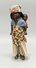 PAIR OF PAINTED BISQUE BLACK DOLLS - 13
