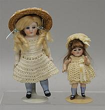PAIR OF ALL BISQUE DOLLS WITH CLOSED MOUTHS, STATIONARY GLASS EYES, BLUE STOCKINGS: 3 1/2