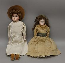 PAIR OF ANTIQUE CLOSED MOUTH BISQUE SLIGHTLY TURNED SOLID DOME SHOULDER HEAD DOLLS: 16