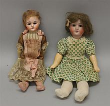 PAIR OF ANTIQUE BISQUE HEAD DOLLS: 10 1/2