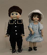 PAIR OF MINT REPRODUCTION BISQUE HEAD DOLLS - 12