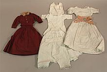 PAIR OF ANTIQUE COTTON DOLL OUTFITS - 3 PC. AND 6 PC. 3 Pc. Outfit - dark red blouse with skirt and  belt. Blouse is 6