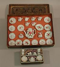 TWO SETS OF ANTIQUE DOLL CHINA IN ORIGINAL BOXES. Both sets are unmarked. Set 1 - unmarked box 4