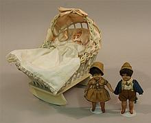 LOT - (3) CELLULOID DOLLS AND WICKER CRADLE: PAIR OF 5