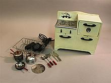 CHILD'S STEEL  TOY EMPIRE NO. 228 ELECTRIC OVEN AND TIN/ALUMINUM COOKWARE. 1940's Wisconsin made white appliance with black trim.