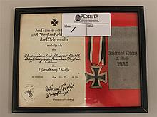 German WW II grouping consisting of an Iron Cross second class with correct issue envelope and award document. Medal is complete wit...