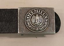 German WW II army combat belt and buckle. Belt is a standard black leather measuring approximately 33 1/2