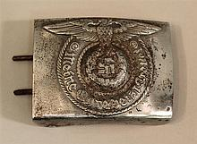German WW II Waffen SS buckle. Stamped steel buckle shows much use and displays a bright bare metal finish on its face with original...