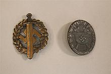 Lot of two German WW II medals. Included are a solid back silver wound badge with little finish remaining but with attachment elemen...