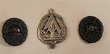 Lot of two German medals and SA tinnie. Lot includes a WW I black wound badge retaining most of its original finish, and an early