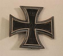 German WW I Imperial Iron Cross 1st class (pin back). Rim of cross displays a nicely oxidized finish. Reverse is unmarked and is com...