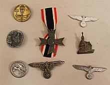 Lot of six pieces German WW II metal insignia. Lot consists of a War Merit Cross 2nd cless without swords, four tinnies from various...