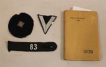 Lot of Hitler youth cloth insignia and calendar book. Group includes three pieces of black cloth uniform insignia all with Hitler yo...