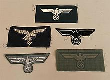 Lot of five  German WW II uniform cloth breast eagles. Lot includes three enlisted machine embroidered Army eagles, one flat wire Am...
