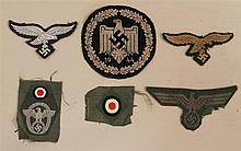 Lot of German WW II embroidered eagle insignia. Lot includes two embroidered Luftwaffe eagles for M43 caps, a bevo embroidered eagle...