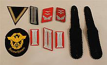 Lot of German WW II cloth insignis. Included are one pair Panzer shoulder boards, and two pairs collar tabs.