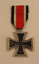 German WW II Iron Cross 2nd class. Medal is complete with original tricolor ribbon attached to large silver ring. Lightly oxidized s...