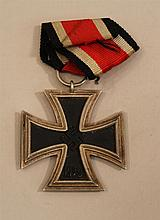 German WW II Iron Cross 2nd class. Silver rim displays light oxidation complete with ribbon.