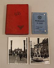 Lot of German WW II paper items. Lot included a 1940 dated photo ID for a member of the Hamburg Schutzpolizei with last notation dat...