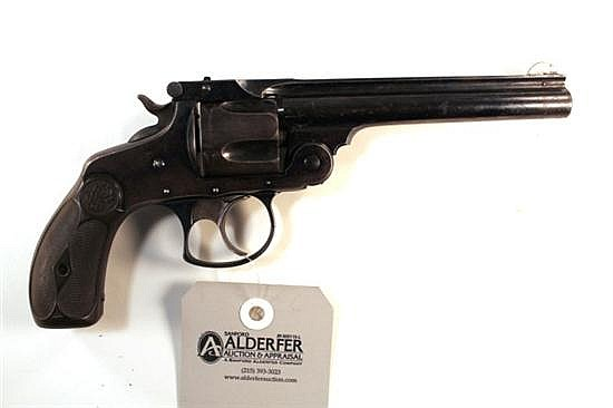 "Smith & Wesson Fourth Model double action revolver. Cal. 38 S&W. 5"" bbl. SN 302537. Blued/patina finish on metal, brown diamond chec..."