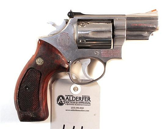 "Smith & Wesson Model 66 Combat Magnum double action revolver. Cal. 357 Mag. 2-1/2"" bbl. SN 6K88371. Stainless steel finish on metal,..."
