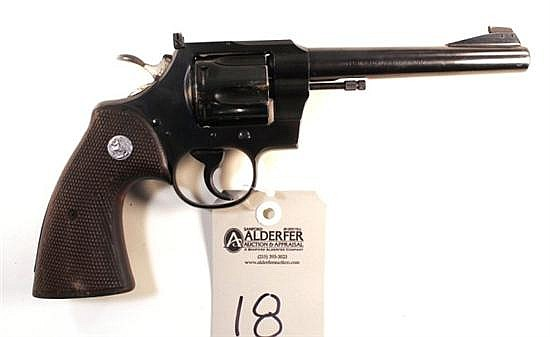 """Colt Officer's Model Match double action revolver. Cal. 22 LR. 6"""" bbl. SN 70597. Blued finish on metal, checkered walnut grips show .."""