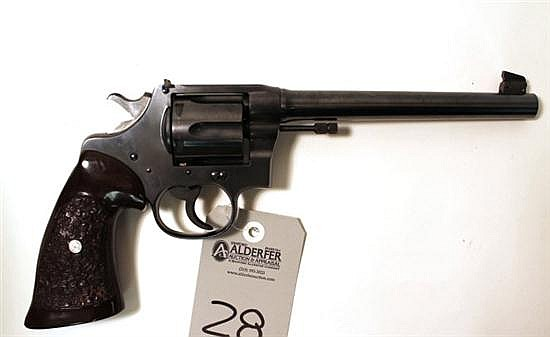 "Colt New Service double action revolver. Cal. 45 Colt. 7-1/2"" bbl. SN 307459. Blued finish on metal, adjustable rear sight, undersid..."